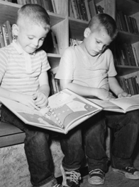 Two boys read books in a bookmobile in Lincoln Parish Louisiana - October 1962.jpg